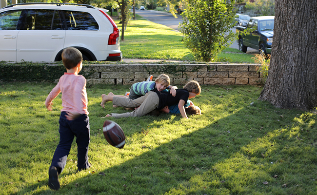 Kids Play Ball in Neighbor's Yard